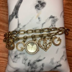 Guess watch bracelet gold tone with charms.